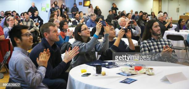 From left students Dylan Ma Matthias Schlichting Madelen Diaz Weijin Xu and Patrick Weidner applaud as they watch a live feed of Professor Michael...