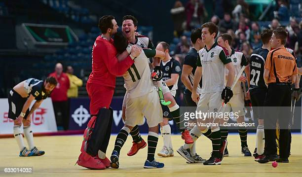 From left Surbiton's Harry Gibson William Marshall and Alan Forsyth celebrate the win during the Maxifuel Super Sixes Mens Final match between...