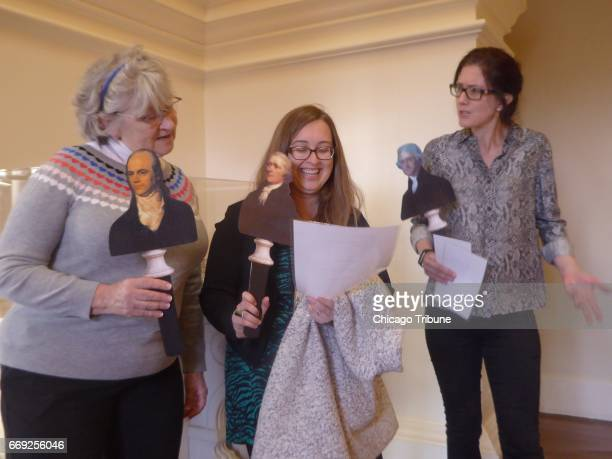 From left Susan Seehaver Mia Magruder and Melanie Bowyer of Charlottesville Va hold Founding Fathers stick puppets of Aaron Burr Alexander Hamilton...