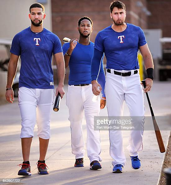 From left Texas Rangers outfielder Nomar Mazara infielder Jurickson Profar and designated hitter Joey Gallo head to photo day during spring training...