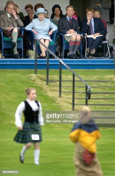 From left The Duke of Edinburgh Queen Elizabeth II The Prince of Wales and Prince William watch the sack race at the Braemar Games in Royal Deeside...