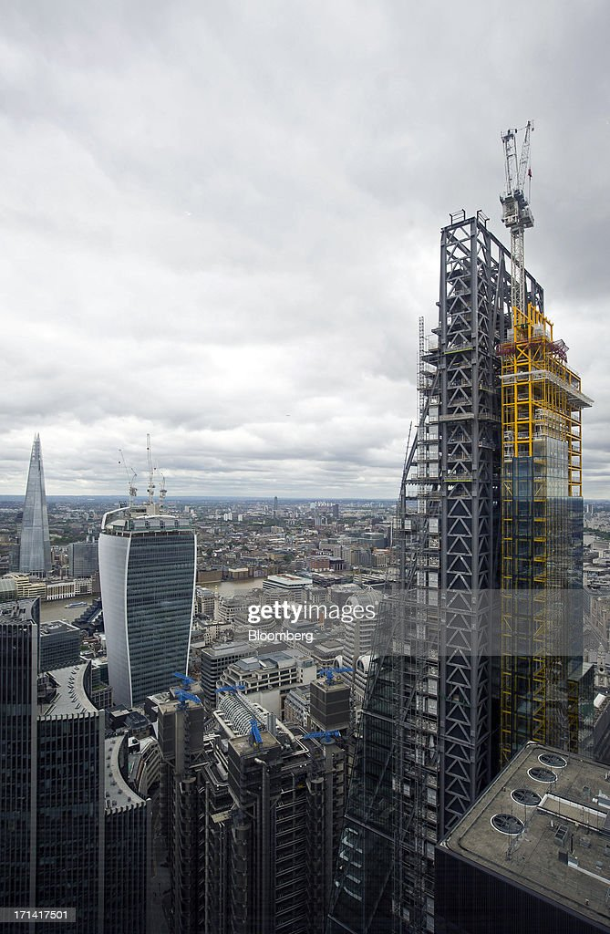 From left, the Shard tower, 20 Fenchurch Street, also known as the 'Walkie-Talkie', and the Leadenhall building, also known as the 'Cheesegrater', are seen from the top of the Swiss Re building, also known as the 'Gherkin', in London, U.K., on Sunday, June 23, 2013. U.K. commercial real estate values rose for the first time in 18 months in May, led by increasing demand for offices, Investment Property Databank Ltd. said. Photographer: Jason Alden/Bloomberg via Getty Images