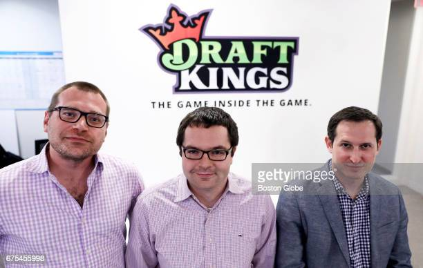 From left the three cofounders of DraftKings Matt Kalish Paul Liberman and Jason Robins pose together in their Boston office on Apr 24 2017 They are...