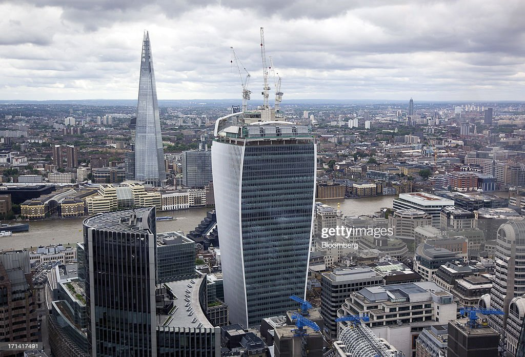 From left, the Willis tower, the Shard tower, and 20 Fenchurch Street, also known as the 'Walkie-Talkie', are seen from the top of the Swiss Re building, also known as the 'Gherkin', in London, U.K., on Sunday, June 23, 2013. U.K. commercial real estate values rose for the first time in 18 months in May, led by increasing demand for offices, Investment Property Databank Ltd. said. Photographer: Jason Alden/Bloomberg via Getty Images