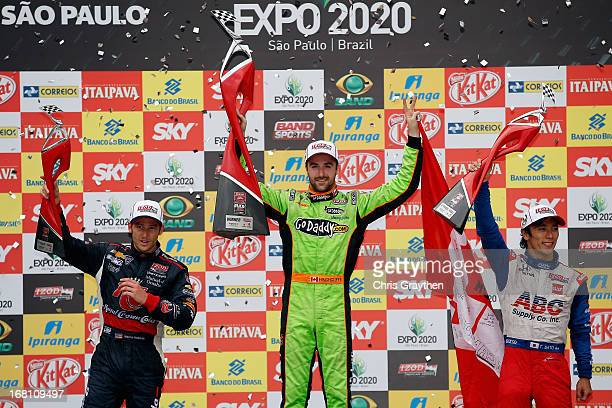 From left third place finisher Marco Andretti driver of the Andretti Autosport Dallara Chevrolet winner James Hinchcliffe of Canada driver of the...