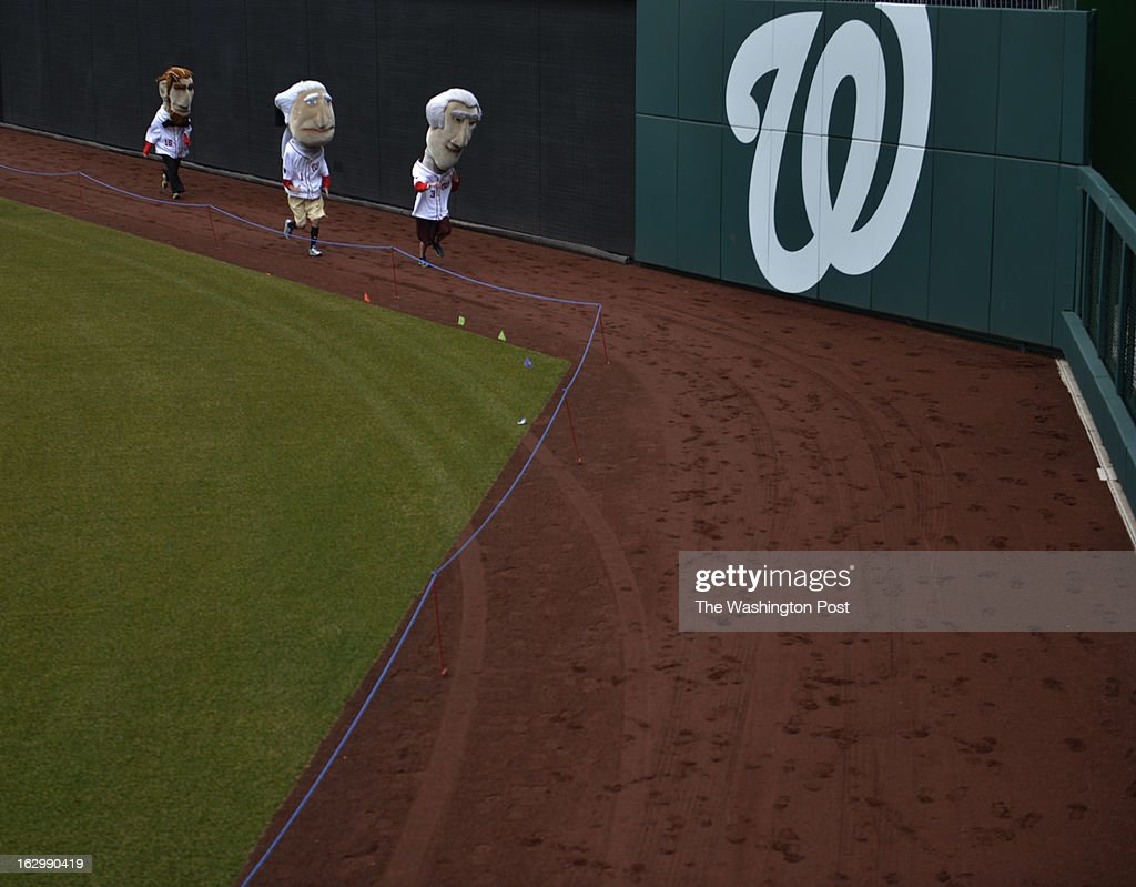 MARCH 02 from left to right, Abe, George and Tom hurry to the finish line as Washington Nationals fans audition to become the next Racing President at Nationals Park in Washington, D.C. on March 02, 2013. Candidates are competing for a chance to fill the shoes of Presidents George Washington, Thomas Jefferson, Abraham Lincoln, Theodore Roosevelt and William Howard Taft. Candidates perform freestyle dance, run a 40-yard dash and run two Presidents Races from center field to the home dugout. Developed in 2006, the Racing Presidents are 12 foot oversized mascots who compete in the GEICO Presidents Race during the fourth inning of every Nationals home game.