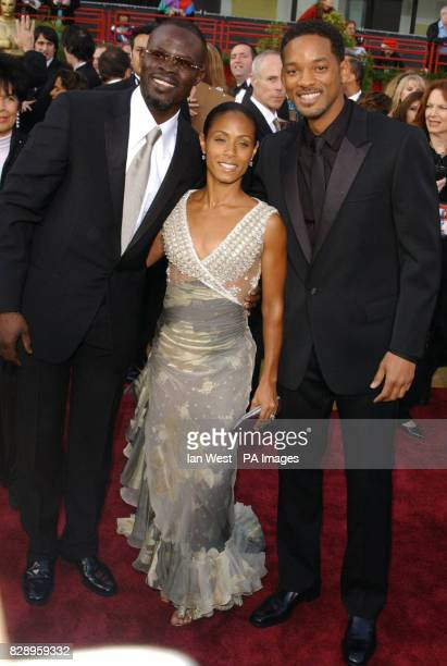 From left to right actor Djimon Hounsou Jada PinkettSmith and husband Will Smith arrive at the Kodak Theatre in Los Angeles for the 76th Academy...