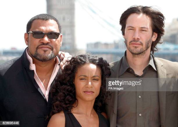 From left to right actor Laurence Fishburne actress Jada PinkettSmith and actor Keanu Reeves pose for photographers during a photocall at Old...