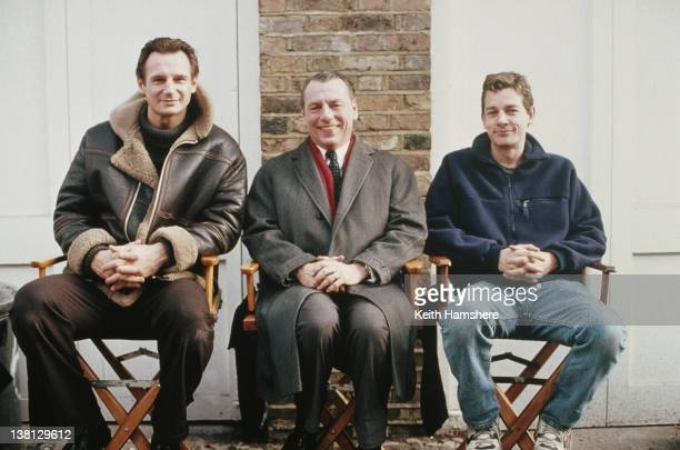 From left to right actor Liam Neeson with costar Kenneth Cranham and writer and director Simon Moore on the set of the thriller 'Under Suspicion' 1991