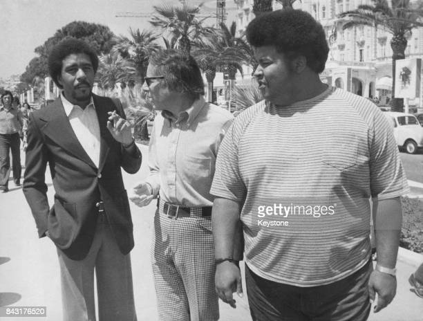 From left to right actor Richard Pryor director Mel Stuart and producer Forest Hamilton on the Croisette during the Cannes Film Festival in France...
