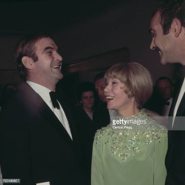 From left to right actor Stanley Baker his wife Ellen and actor Sean Connery at the premiere of the film 'Shalako' at the Odeon Leicester Square...