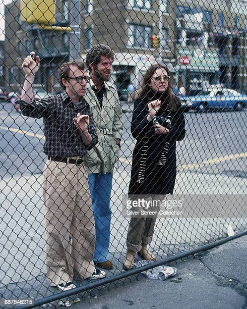 From left to right actor writer and director Woody Allen as Alvy Singer actor Tony Roberts as Rob and actress Diane Keaton as Annie Hall in the film...