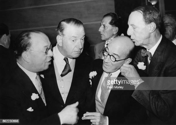 From left to right actors and comedians Ralph Lynn Robertson Hare director Austin Melford and actor Leslie Henson share a joke at the wedding...