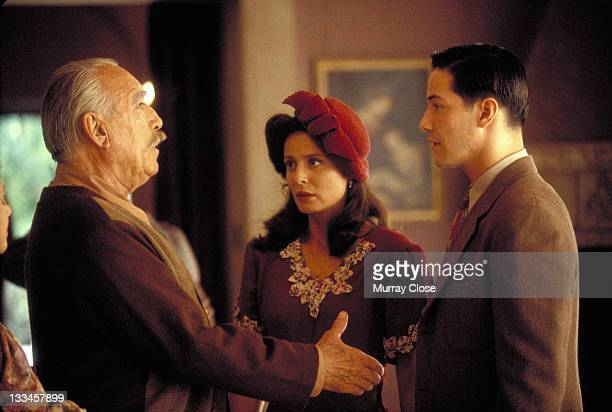 From left to right actors Anthony Quinn Aitana SanchezGijon and Keanu Reeves star in the film 'A Walk in the Clouds' 1995