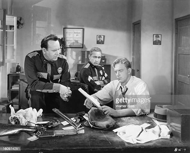 From left to right actors Don Shelton James Whitmore and James Arness in a scene from the film 'Them' featuring giant mutant killer ants 1954