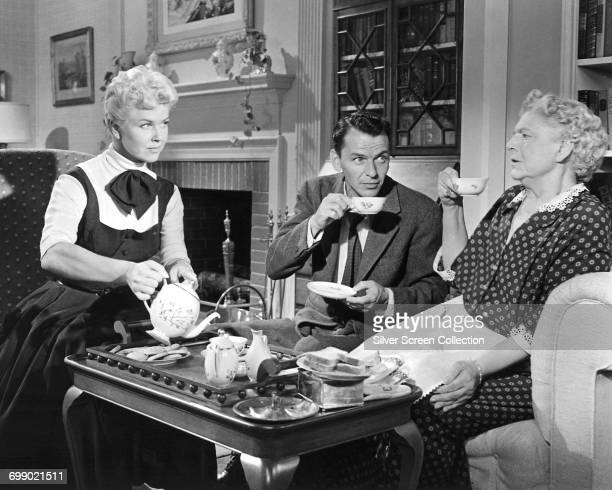 From left to right actors Doris Day as Laurie Tuttle Frank Sinatra as Barney Sloan and Ethel Barrymore as Aunt Jessie Tuttle in the musical film...