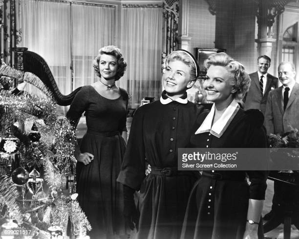 From left to right actors Dorothy Malone as Fran Tuttle Doris Day as Laurie Tuttle and Elisabeth Fraser as Amy Tuttle in the musical film 'Young at...