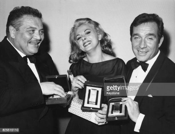 From left to right actors Folco Lulli Sandra Milo and Ugo Tognazzi receive Nastri d'Argento at the Italian National Syndicate of Film Journalists...