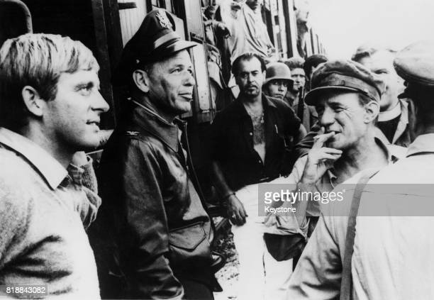 From left to right actors John Leyton Frank Sinatra and Trevor Howard during the filming of 'Von Ryan's Express' in Rome Italy 3rd September 1964