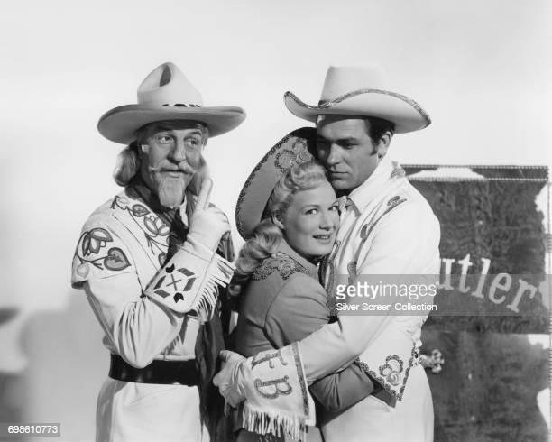 From left to right actors Louis Calhern as Col Buffalo Bill Cody Betty Hutton as Annie Oakley and Howard Keel as Frank Butler in the musical film...
