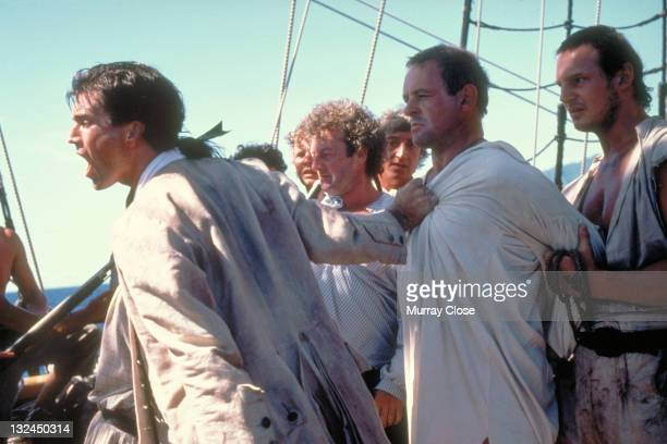 From left to right actors Mel Gibson Bernard Hill Anthony Hopkins and Liam Neeson in a scene from the film 'The Bounty' 1984