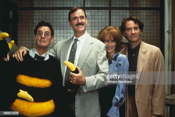 From left to right actors Michael Palin John Cleese Jamie Lee Curtis and Kevin Kline star in the film 'Fierce Creatures' 1997
