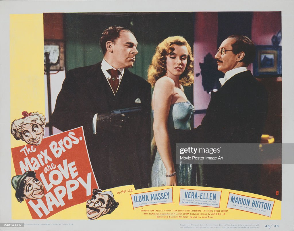 From left to right actors Raymond Burr Marilyn Monroe and Groucho Marx appear on the poster for the Marx Brothers film 'Love Happy' 1949