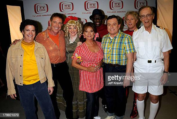 From left to right actors Ron Palillio Barry Williams Alison Arngrim Dawn Wells Jimmie Walker Jerry Mathers William Katt and Bernie Kopell backstage...