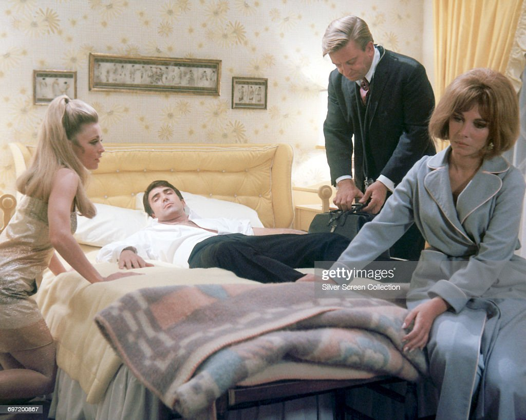 From left to right, actors Sharon Tate as Jennifer North, Tony Scotti as Tony Polar, William Wintersole as the doctor and Lee Grant as Miriam Polar in a scene from the film 'Valley of the Dolls', 1967.