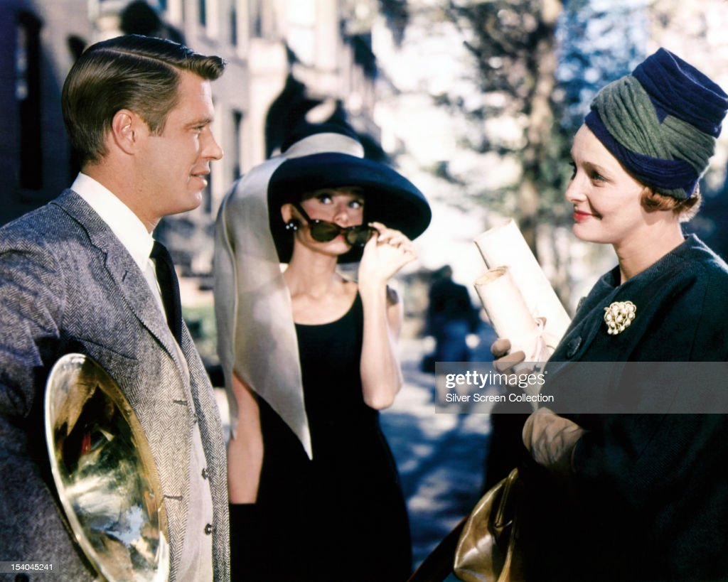 From left to right American actor George Peppard as Paul Varjak Belgianborn actress Audrey Hepburn as Holly Golightly and American actress Patricia...
