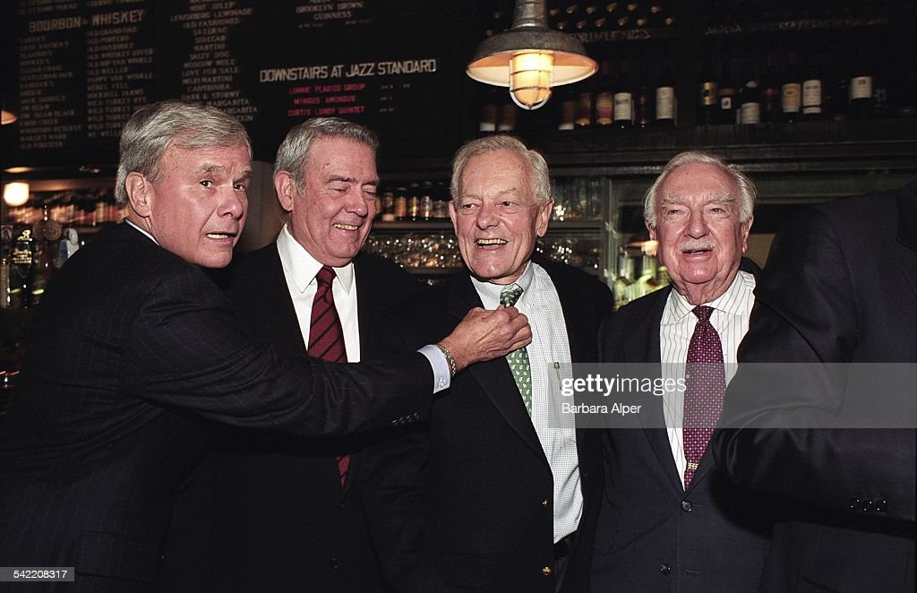 From left to right, American broadcast journalists Tom Brokaw, Dan Rather, Bob Schieffer and Walter Cronkite attending a book-signing party for Bob Schieffer's book 'This Just In: What I Couldn't Tell You on TV' at Blue Smoke in New York City, 29th January 2003.