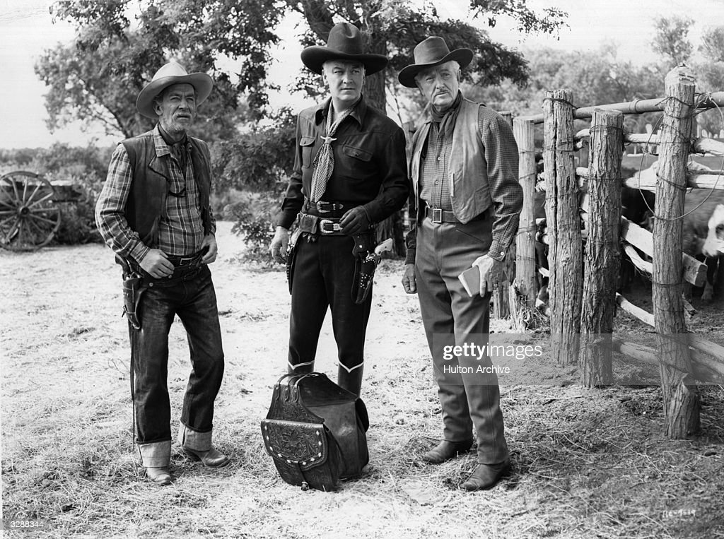 From left to right, <a gi-track='captionPersonalityLinkClicked' href=/galleries/search?phrase=Andy+Clyde&family=editorial&specificpeople=90273 ng-click='$event.stopPropagation()'>Andy Clyde</a> (1892 - 1967), <a gi-track='captionPersonalityLinkClicked' href=/galleries/search?phrase=William+Boyd&family=editorial&specificpeople=94242 ng-click='$event.stopPropagation()'>William Boyd</a> (1895 - 1972) and Herbert Rawlinson (1885 - 1953) in a scene from the Hopalong Cassidy film 'Silent Conflict'. Title: Silent Conflict Studio: United Artists Director: George Archainbaud