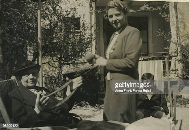 From left to right Anne Frank's paternal grandmother Alice FrankStern family friend Annelise Schutz and Anne's cousin Bernhard or 'Buddy' Elias relax...