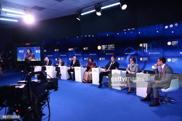 From left to right Anton Siluanov Russia's finance minister Kristalina Georgieva chief executive officer of World Bank Group Eric Dugelay partner at...