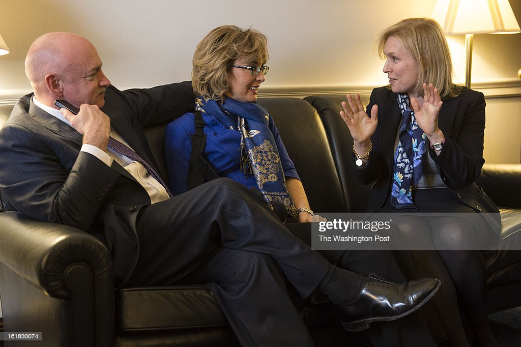 From left to right, astronaut Mark Kelly and former Congresswoman Gabrielle Giffords chat with friend, Sen. Kirsten Gillibrand (D-NY) as they made the rounds to talk about the issue of gun violence on Capitol Hill in Washington, D.C., on Wednesday, February 13, 2013.