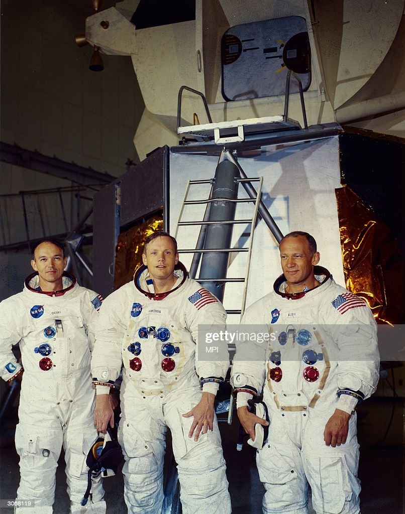From left to right astronauts Michael Collins Neil Armstrong and Edwin 'Buzz' Aldrin Jnr the crew of the lunar module Apollo 11 stand in front of a...