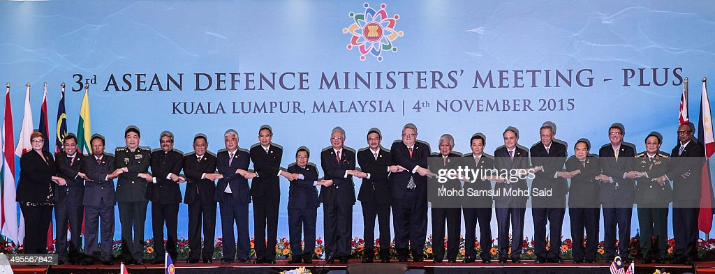 From left to right, Australia's Defense Minister Marise Payne, Brunei's Defense Minister Mohammad Yasmin Umar, Cambodia's Defense Minister Gen. Tea Banh, China's Defense Minister Chang Wanquan, India's Defense Minister Manohar Parrikar, Indonesia's Defense Minister Ryamizard Ryacudu, Japan's Defense Minister Gen Nakatani, Myanmar's Defense Minister Sein Win, Laos' Defense Minister Sengnouane Sayalat, Malaysia's Prime Minister Najib Razak, Malaysia's Defense Minister Hishamuddin Hussein, New Zealand's Defense Minister Gerry Brownlee, Philippines' Secretary of Defense Voltaire Gazmin, South Korea's Defense Minister Han Min Koo, Russia's Deputy Defense Minister Anatoly Antonov, Singapore's Defense Minister Ng Eng Hen, Thailand's Defense Minister Gen. Prawit Wongsuwon, U.S. Defense Secretary Ash Carter and Vietnam's Deputy Defense Minister Nguyen Van Hein joint hands as they pose for photographers after during the ASEAN defence ministers meeting plus 2015 on November 4, 2015 in Kuala Lumpur, Malaysia. Asean face pressure to back China on the South China Sea issue, while the US and Japan are pushing to get concerns about the dispute included in a statement to be issued after regional defence talks.