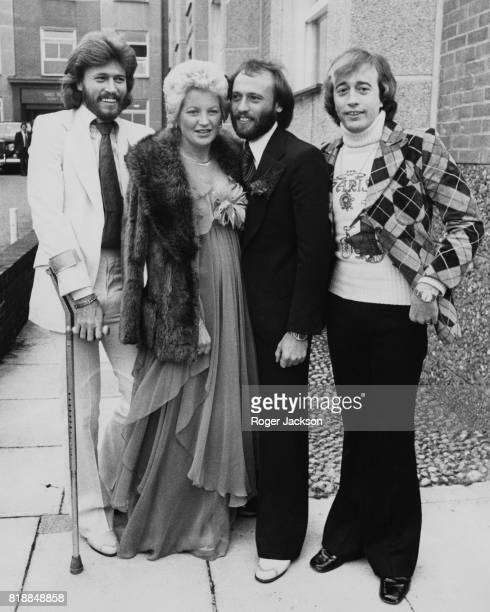 From left to right Barry Gibb Yvonne Spenceley Maurice Gibb and Robin Gibb of the Bee Gees at the wedding of Maurice and Yvonne at Haywards Heath...