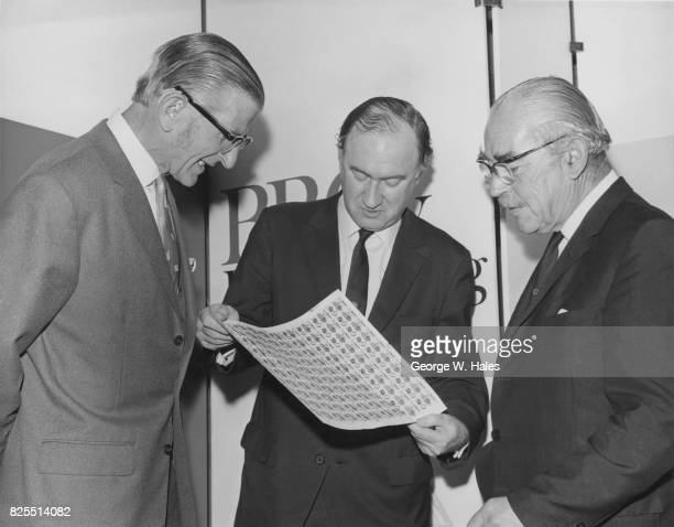 From left to right BBC newsreader Alvar Lidell Charles Curran DirectorGeneral of the BBC and newsreader John Snagge OBE with a sheet of new stamps...
