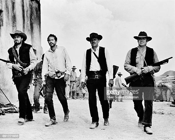 From left to right Ben Johnson as Tector Gorch Warren Oates as Lyle Gorch William Holden as Pike Bishop and Ernest Borgnine as Dutch Engstrom in 'The...