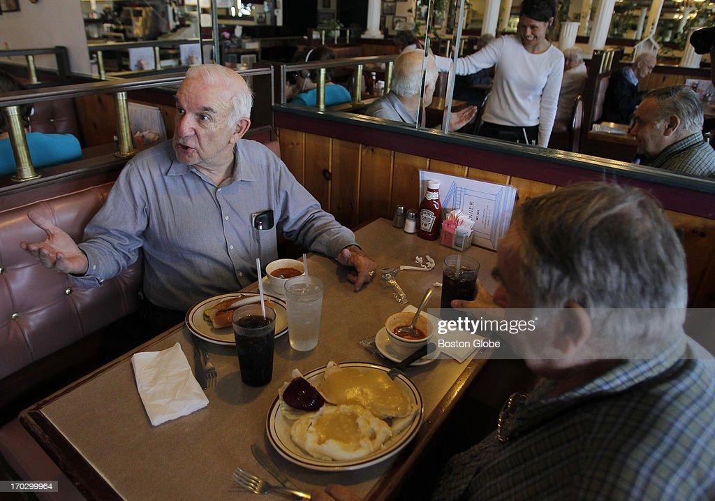 Bernie Cote, of Nashua, a regular at Roland's Restaurant speaks with server Michelle Putnam also of Nashua as Don Dube, of Nashua, looks on in Nashua, NH, June 4, 2013.