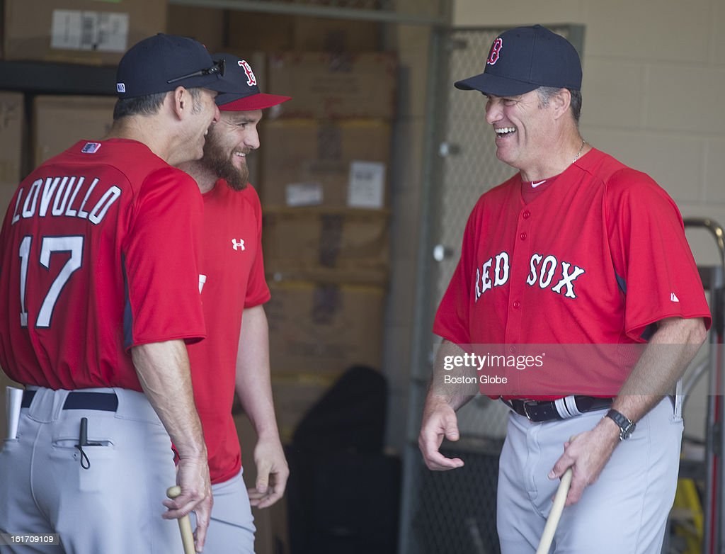 Boston Red Sox Torey Lovullo, bench coach, Jonny Gomes, and manager John Farrell in the equipment room before taking the field. Day two of spring training at the Red Sox training facilities at JetBlue Park on Wednesday, Feb. 13, 2013.