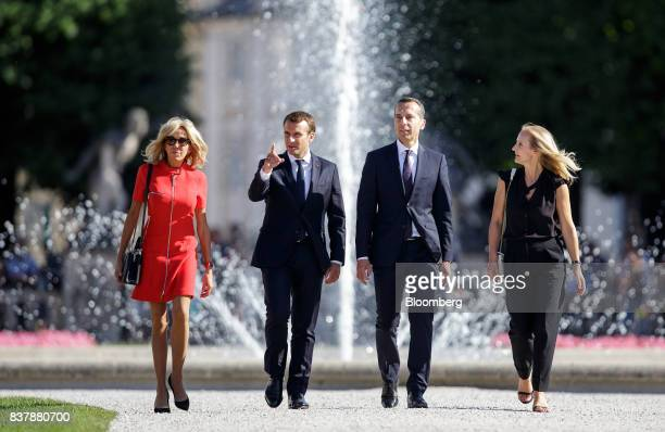 From left to right Brigitte Macron France's first lady Emmanuel Macron France's president Christian Kern Austria's chancellor and his wife Eveline...