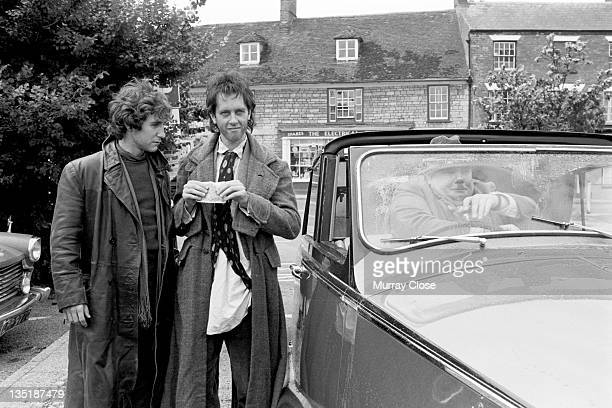 From left to right British actors Paul McGann Richard E Grant and Richard Griffiths film a scene in Stony Stratford Buckinghamshire for the movie...