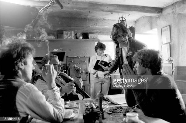 From left to right British actors Richard E Grant Richard Griffiths and Paul McGann film a scene in Cumbria for the movie 'Withnail I' 1986 British...