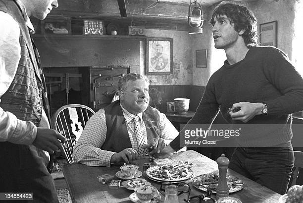 From left to right British actors Richard E Grant Richard Griffiths and Paul McGann film a scene in Cumbria for the movie 'Withnail I' 1986