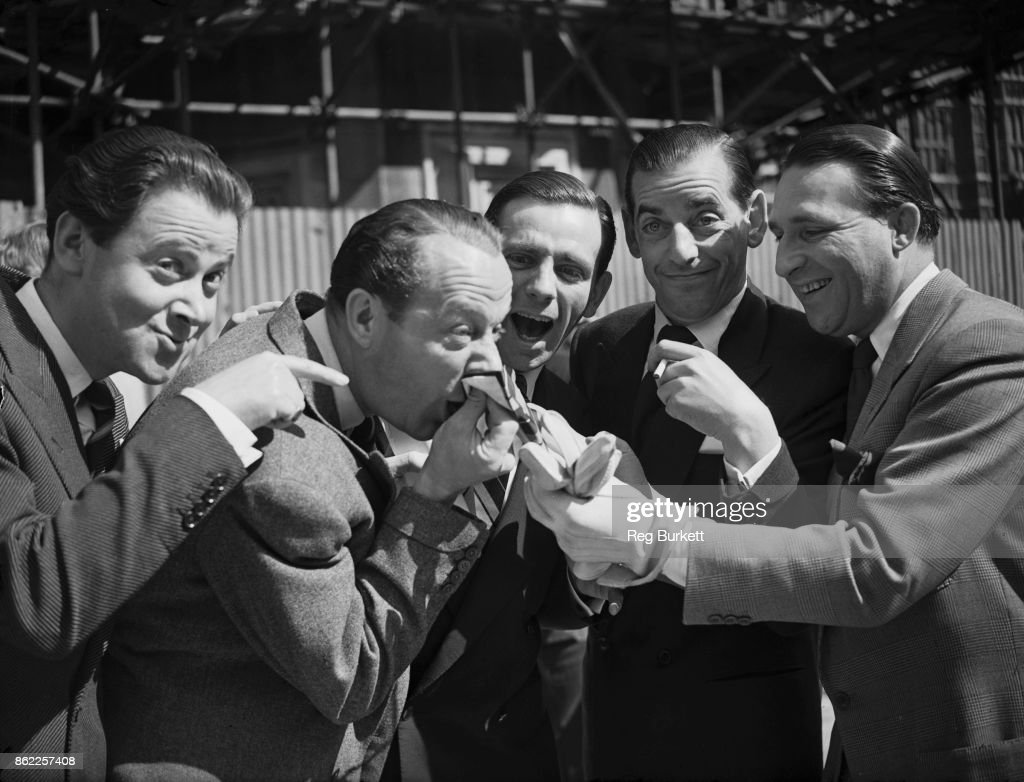 From left to right, British comedians Derek Roy (1922 - 1981), Ben Warriss (1909 - 1993), Norman Wisdom (1915 - 2010), Jimmy Jewel (1909 - 1995) and Charlie Chester (1914 - 1997), 22nd May 1952. They are facing allegations at the House of Commons that they will not tour Korea and Malaysia due to lucrative engagements in Britain.