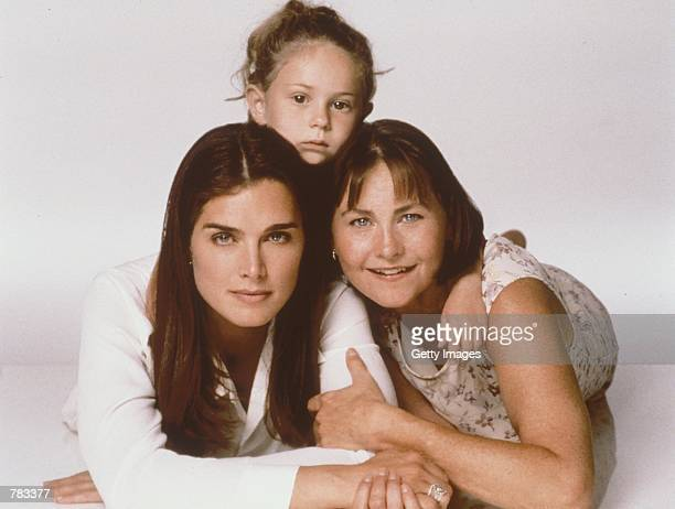 From left to right Brooke Shields Gordy Bennattar and Cherry Jones pose for a photo for Lifetime television's drama 'What Makes A Family' based on a...