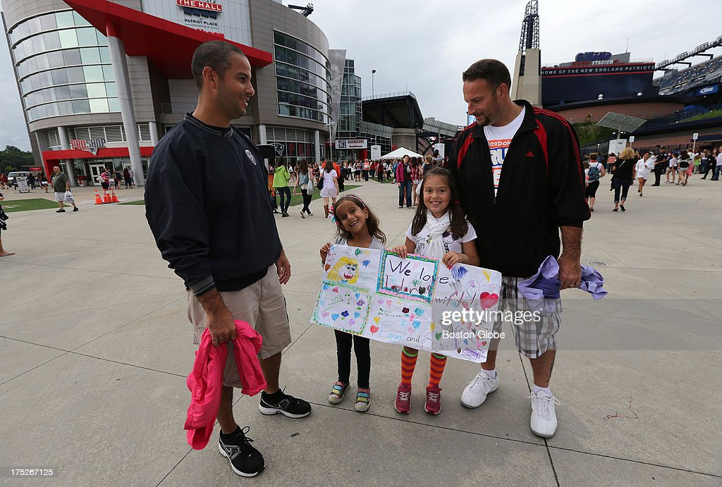 brothers Brian Karoul, of Manchester, N.H., with daughter Sofia, 7, and Peter Karoul, of Braintree and daughter Emma, 7, at tonight's concert. Dads and daughters going to Taylor Swift concert at Gillette Stadium in Foxborough.