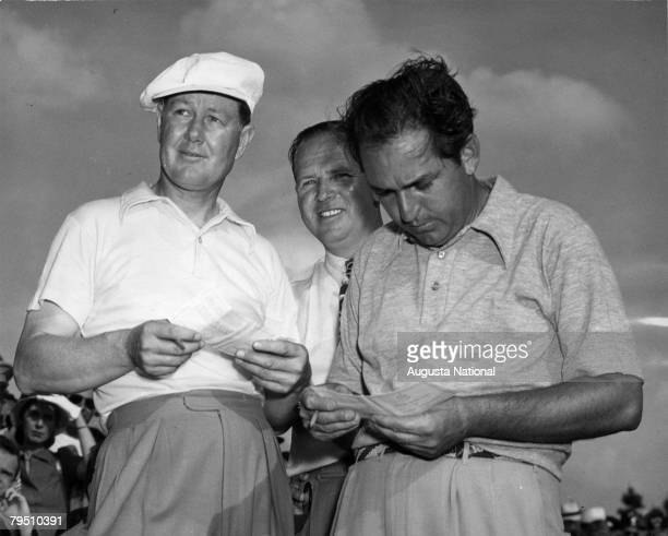 Byron Nelson Ralph Hutchison and Claude Harmon review scorecards at the 1948 Masters Tournament